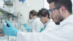 Latin Ethnicity Student Working in Laboratory of Chemistry Classroom Stock Footage