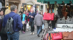 Street of Rome Italy. Tourists and  souvenir shops and clothing stores handbags Stock Footage