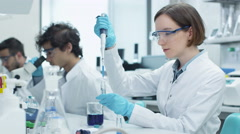 Group of Multiethnic Students in Coats Working in Laboratory Stock Footage