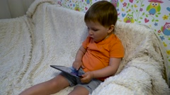 Baby with tablet Stock Footage