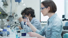 Group of Multiethnic Students Working in Laboratory of Chemistry Classroom Stock Footage