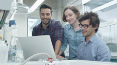 Group of Multiethnic Students using Laptop in Laboratory of Chemistry Classroom Stock Footage