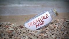 Treasure map inside a bottle Stock Footage