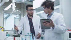 Group of Multiethnic Students using Tablet in Laboratory of Chemistry Classroom Stock Footage