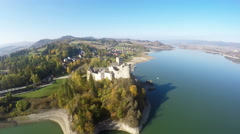 Aerial footage of Niedzica Castle at Czorsztyn Lake in Poland Stock Footage