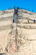 People visiting the highest sand dune of Pyla in Europe - stock photo