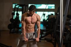Bodybuilder Exercising Triceps Stock Photos