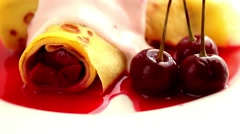 pancake with cherries and cream on the plate - stock footage