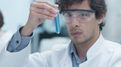 Latin Ethnicity Scientist in Safety Glasses Does Researches. Stock Footage