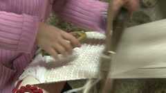 Weaver working on a traditional loom. Stock Footage