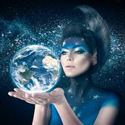 Moon woman holding planet earth Kuvituskuvat