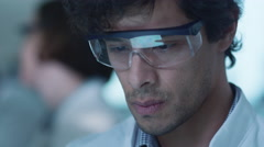 Latin Ethnicity Scientist using Tablet Computer, having Reflection in Glasses Stock Footage