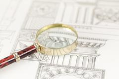 Magnifying glass & architectural drawing Stock Photos