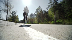 Female runner jogging on mountain road training for marathon. Stock Footage