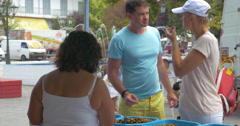 Couple tasting and buying olives on street market Stock Footage