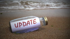 update written on a message washed ashore - stock footage