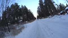 Girls Play On The Road And Go To Yard in Winter Snow Forest, medium shoot Stock Footage