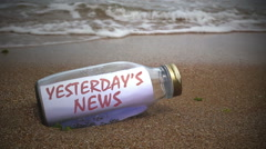 yesterdays news written on a message washed ashore - stock footage