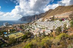 Los Gigantes,Spain - 19 March 2015:The town and harbour seen from the cliffs Stock Photos