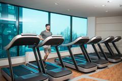 Young Man Exercising On A Treadmill Stock Photos