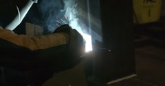 A man working on the welding machine Stock Footage