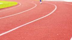 Woman running in stadium. Beautiful Sport Background Stock Footage