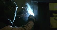 The worker intently working on the welding machine Stock Footage