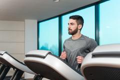 Fitness Man Running On Treadmill - stock photo