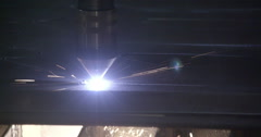 The plasma cutter making a pattern on the sheet Stock Footage