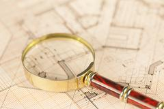 Architecture blueprint -  house plans & magnifying glass Stock Photos