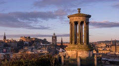 4K Time lapse of the Sunrise on the iconic Calton Hill, Edinburgh, Scotland, UK Stock Footage