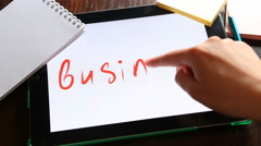 Business concept, hand writes word business on tablet at workplace - stock footage
