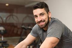 Young Man Cycling On Bike Bodybuilding Trainer Stock Photos
