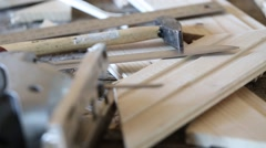 Fretsaw, hammer, knife and tongue and groove boards on working place Stock Footage
