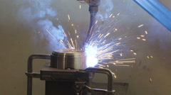 The big welding machine working on a metal part Stock Footage