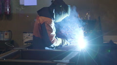 A worker in full suite working on the welding machine Stock Footage