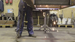 Sparks from welding machine under the table Stock Footage