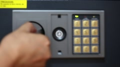 Male hand pushing security code and putting money and passports in safety box Stock Footage