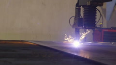 A big metal sheet being cut by the plasma cutter Stock Footage