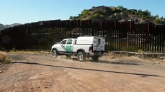 A US Border Patrol truck going along the fence - stock footage