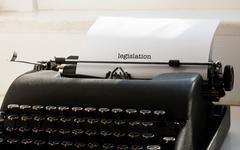 Legislation against typewriter on a table - stock photo