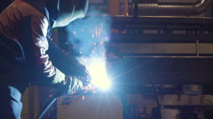 The man in yellow suit on the welding machine Stock Footage