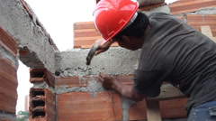 A Latin American construction worker uses a hammer Stock Footage