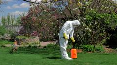 Gardener working with pump sprayer in the yard Stock Footage