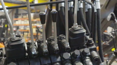 The hydraulic valve hoses of the machine Stock Footage