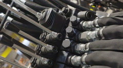 Hydraulic hoses in the valve Stock Footage