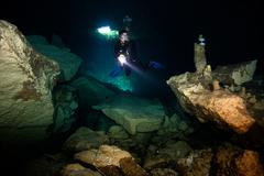 Scuba diver in  cavern. Stock Photos