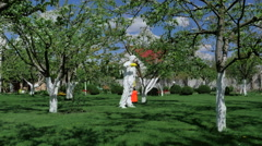Man in protective clothing working in the yard Stock Footage