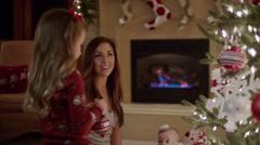 Medium panning shot of family decorating Christmas tree / Cedar Hills, Utah, Stock Footage