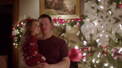Medium shot of father and daughter admiring Christmas tree / Cedar Hills, Utah, Stock Footage